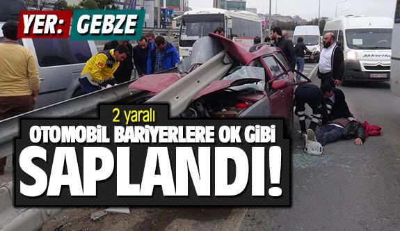Otomobil bariyere ok gibi saplandı: 2 yaralı