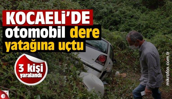 Kocaeli'de dere yatağına devrilen otomobildeki 3 kişi yaralandı